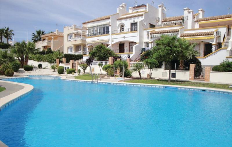 1162168,Apartamento en Orihuela Costa, en la Costa Blanca, España  con piscina privada para 6 personas...