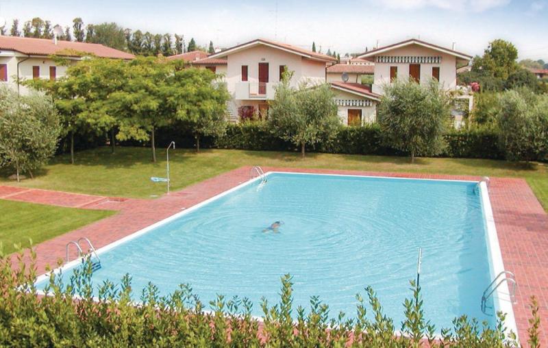 Gli ulivi 1160363,Apartamento en Colà Di Lazise Vr, Lake Garda, Italia  con piscina privada para 7 personas...