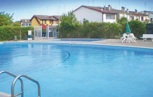 Calabria g41 1163077,Apartamento  con piscina privada en Lido Degli Scacchi Fe, Emilia-Romagna, Italia para 4 personas...