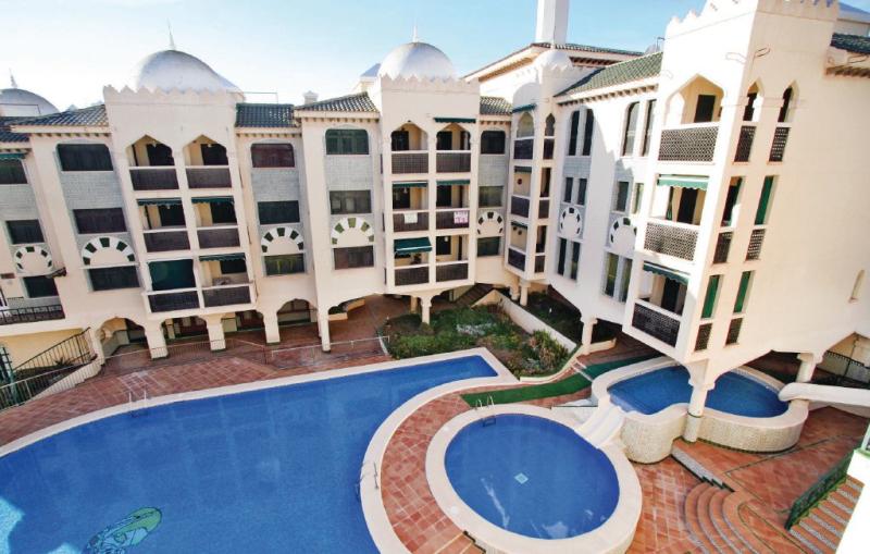 1195565,Apartamento  con piscina privada en Santa Pola, en la Costa Blanca, España para 4 personas...